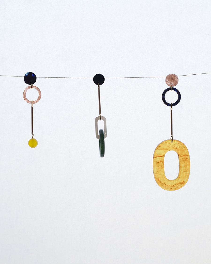 IUO Earrings on a string
