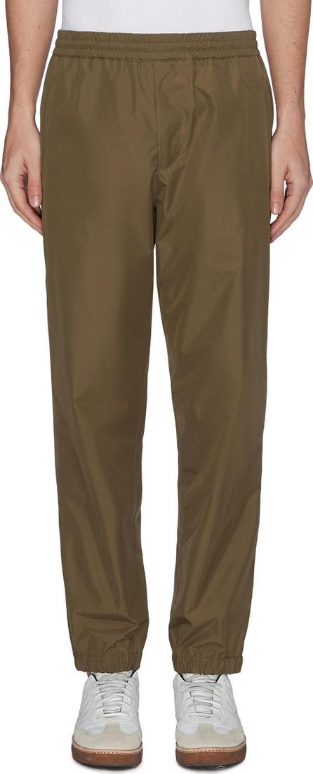 Helmut Lang Reflective logo slogan print water-repellent track pants