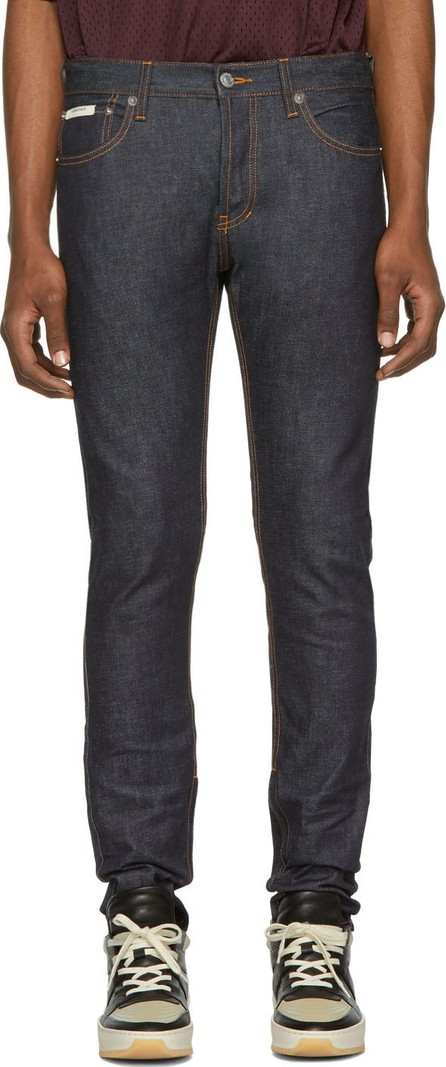 Essentials Indigo Raw Denim Skinny Taper Jeans